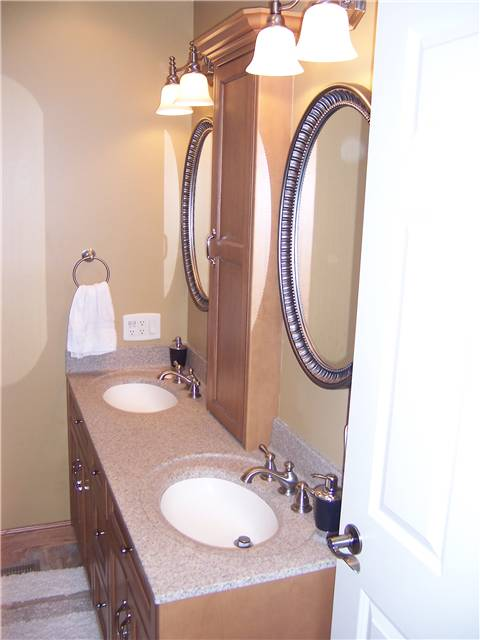 Maple cabinets - Flat panel doors and drawer fronts - Full overlay style - Cultured granite countertop with integral sinks