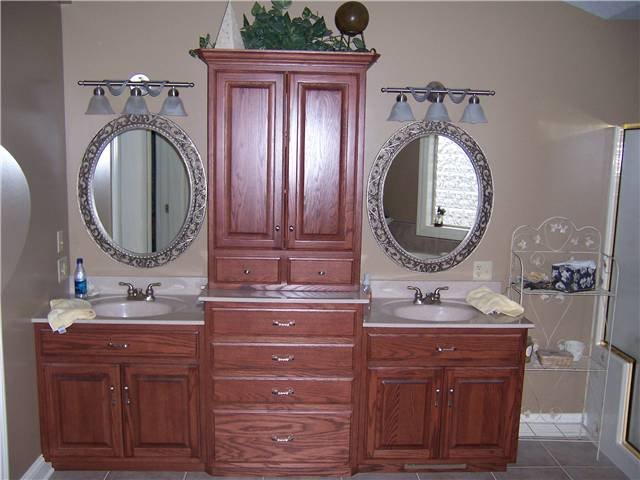 Red oak cabinets - Raised panel doors - Standard overlay style - Cultured marble countertops with integral sinks