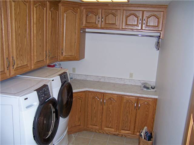 Oak cabinets - laminate countertop - Clothes rod