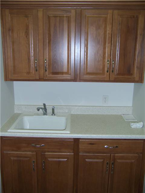 Hickory cabinets - laminate countertop - Drop-in utility sink
