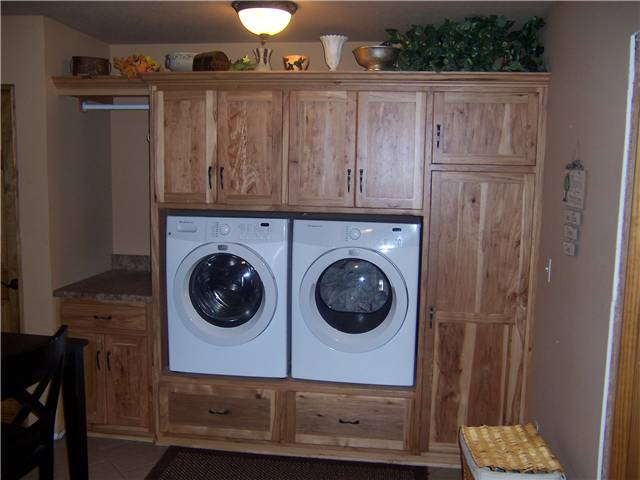 Rustic hickory cabinets - Wood drawers under the washer and dryer - Clothes rod