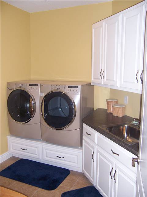 Painted cabinets - Laminate countertop - Wood drawers under the washer and dryer