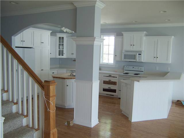 Painted cabinets - Flat panel doors and drawer fronts - Standard overlay style - Solid surface countertops