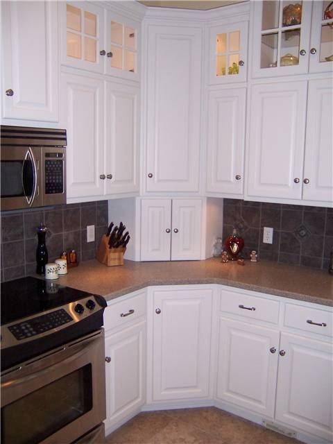 Corner cabinets - upper, lower, and appliance garage - doors closed