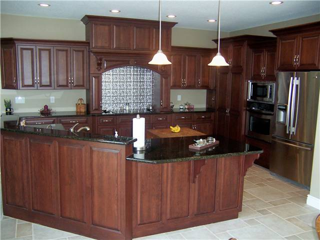 Kitchen featuring a wood cooking enclosure with an exhaust hood hood