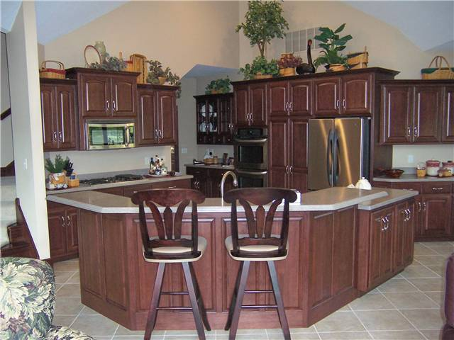 Hickory cabinets - Raised panel doors and side panels - Standard overlay style - Corian solid surface countertops