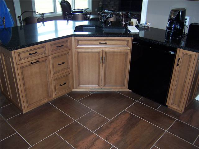 Maple wood with light brown stain and dark glaze
