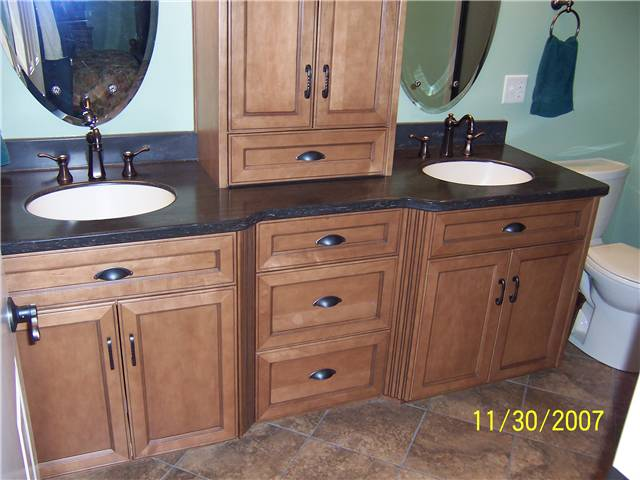 Maple wood with medium brown stain and dark glaze