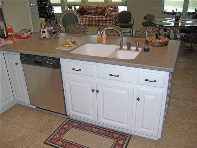 Solid surface peninsula countertop with an undermount solid surface sink