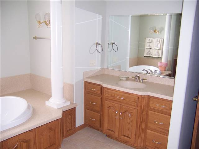 Solid surface countertop, undermount sink, tub deck, and backsplash