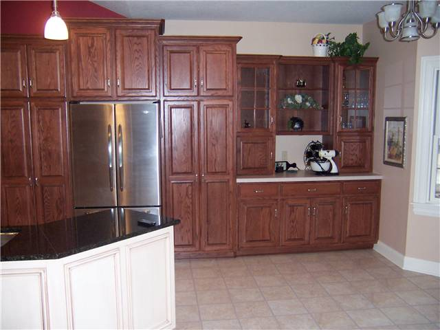 Red oak cabinets - raised panel doors - Standard overlay style