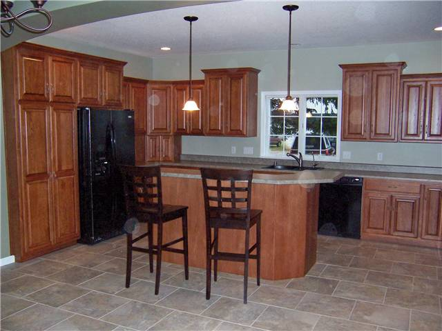 Hickory cabinets - Raised panel doors - Standard overlay style - Laminate countertops