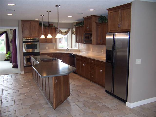 Maple cabinets - Flat panel doors, drawer fronts, and side panels - Full overlay style - Corian solid surface countertops
