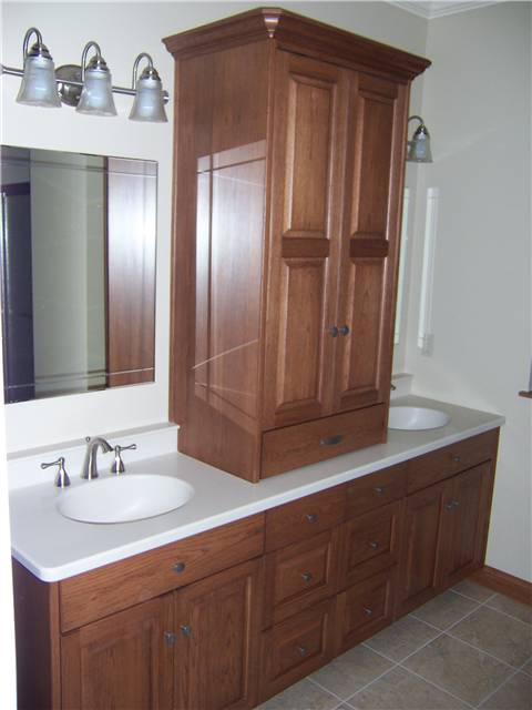 Hickory cabinets - Raised panel doors - Full overlay style - Corian solid surface countertop with integral sinks