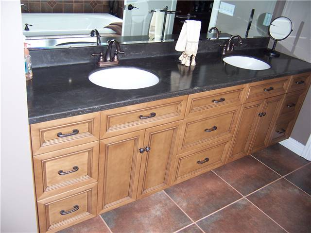 Maple cabinet stained and glazed - Flat panel doors and drawer fronts - Full overlay style - Corian solid surface countertop with integral sinks