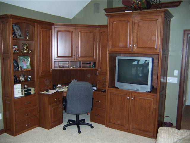 Corner desk/entertainment cabinets in Hickory