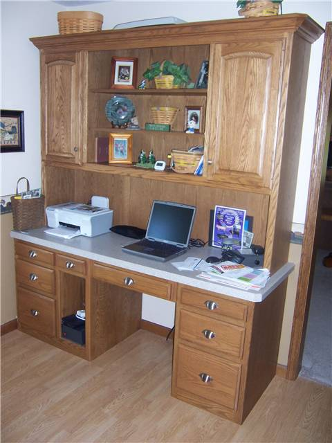 Oak computer desk with file drawers,keyboard tray, and upper display/storage cabinet