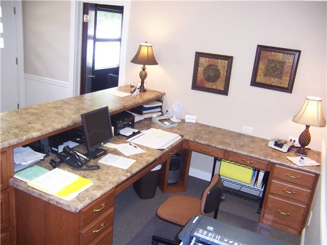 Receptionist desk for an insurance agency - hickory cabinetry with laminate countertops