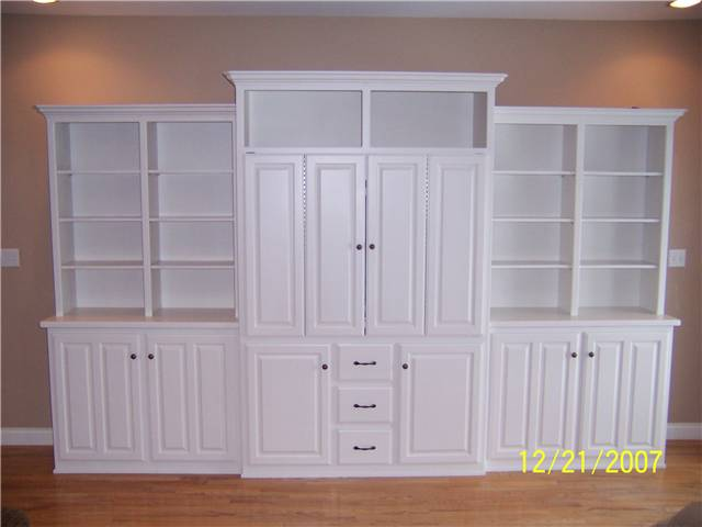 Entertainment with bifold pocket doors/Bookshelves/Storage - painted
