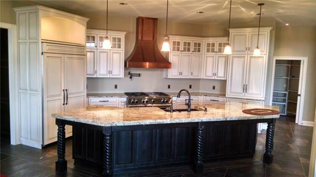 Painted and glazed perimeter cabinets - Maple island with Tobacco stain - Granite countertops