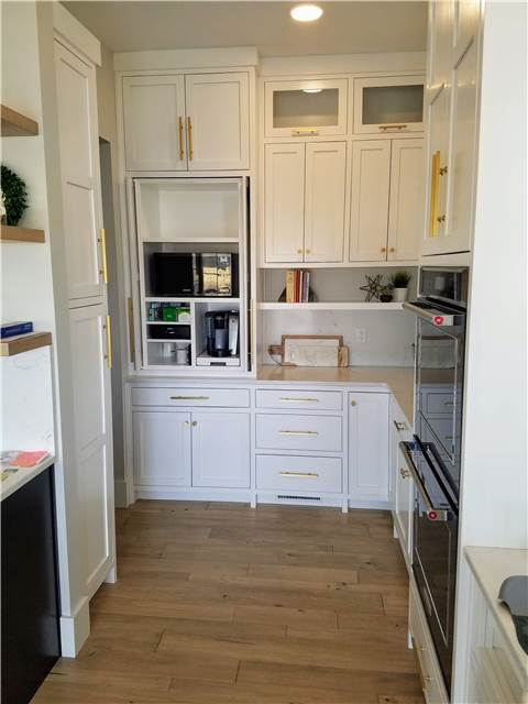 Enclosed coffee/microwave cabinet with pocket doors