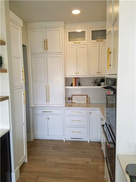 Painted coffee/microwave cabinet with pocket doors