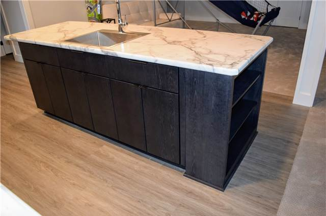 Stained hickory island - Laminate countertop - slab fronts