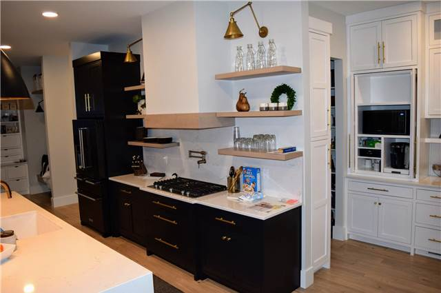 Painted cabinets - stained floating shelves - Quartz countertops and backsplash
