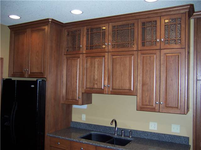 Hickory cabinets - Raised panel doors - Arts and Crafts glass doors - Full overlay style - Quartz countertop