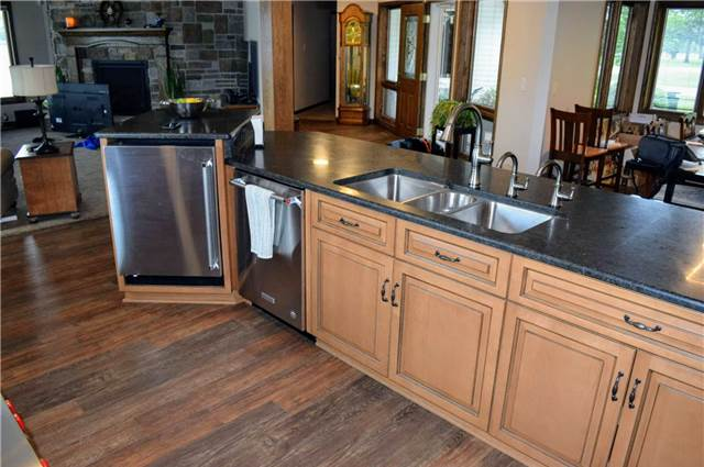 Stained & glazed maple island cabinets - honed granite countertops