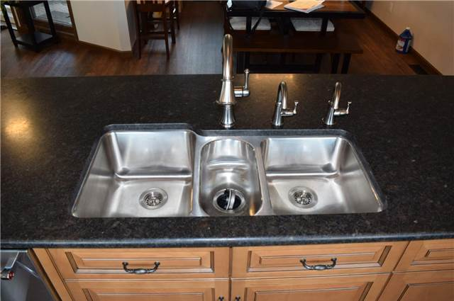 Oversize stainless undermount sink - honed granite countertop