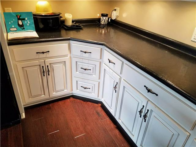 Painted and glazed cabinets -laminate countertops
