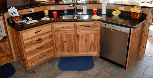 Rustic hickory with light stain - Granite countertops