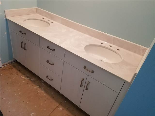 Slab front painted oak cabinet - full overlay style - Cultured marble countertop with undermount porcelain sinks