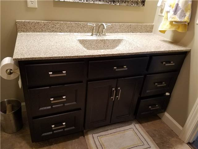 Dark stain cabinet - cultured granite countertop