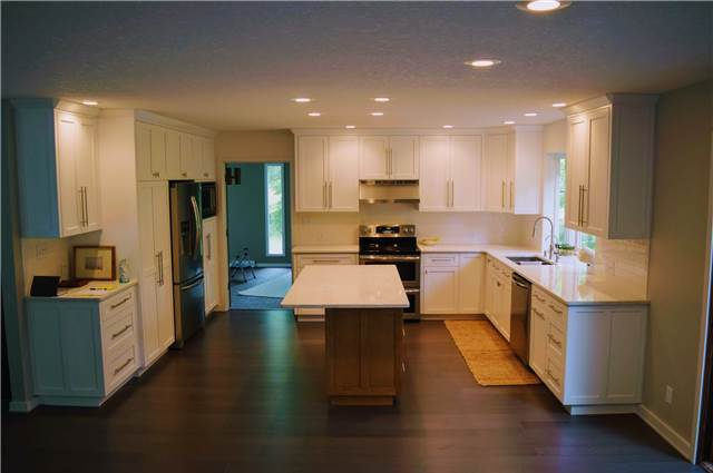 Painted perimeter cabinets - Stained maple island - Quartz countertops