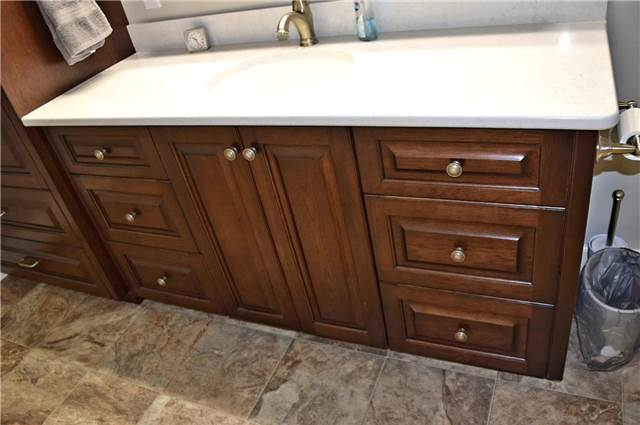 Stained hickory cabinet - Quartz countertop