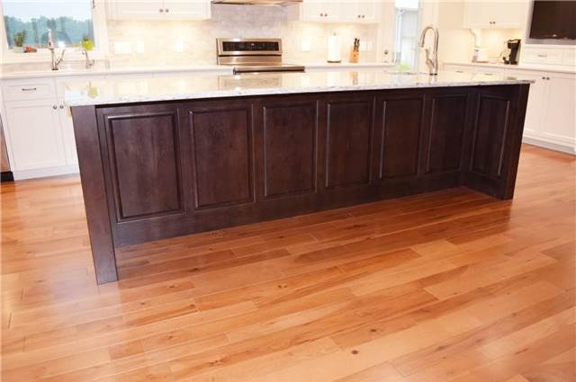 Stained rustic hickory island - Quartz countertop