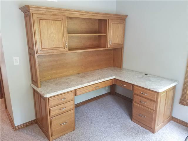 Hickory desk with a laminate countertop
