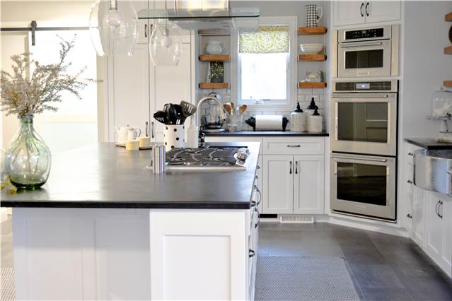 Painted cabinetry - flat panel - full overlay style - Soapstone countertops