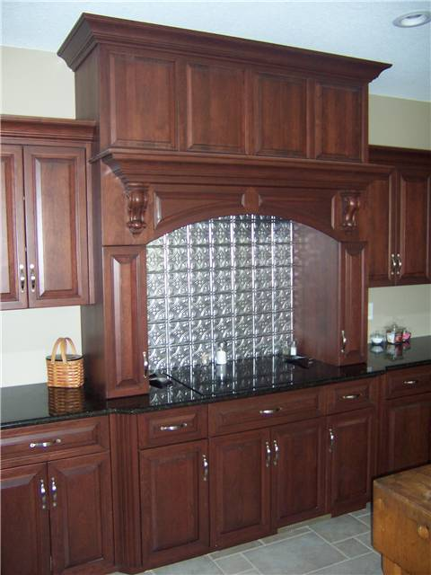 Cherry cooking enclosure - Raised panels miter corner - Full overlay style - Granite countertops
