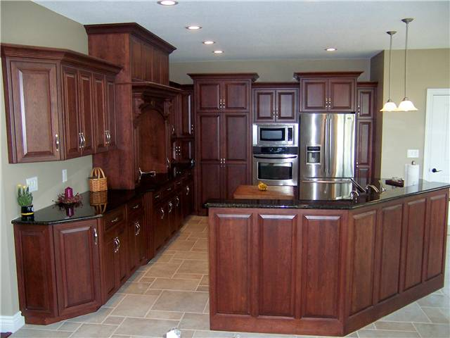 Cherry cabinets - Raised panel miter corner doors and drawer fronts - Full overlay style - Granite countertops