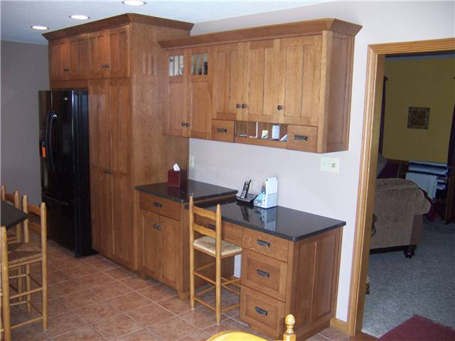 Quartersawn white oak cabinets - Flat panel doors - Full overlay style - Quartz countertops
