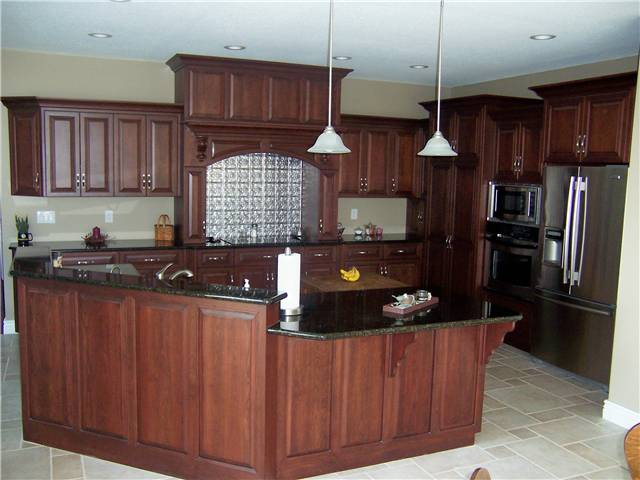 Cherry cabinets - Raised panel miter corner doors - Full overlay style - Granite countertops