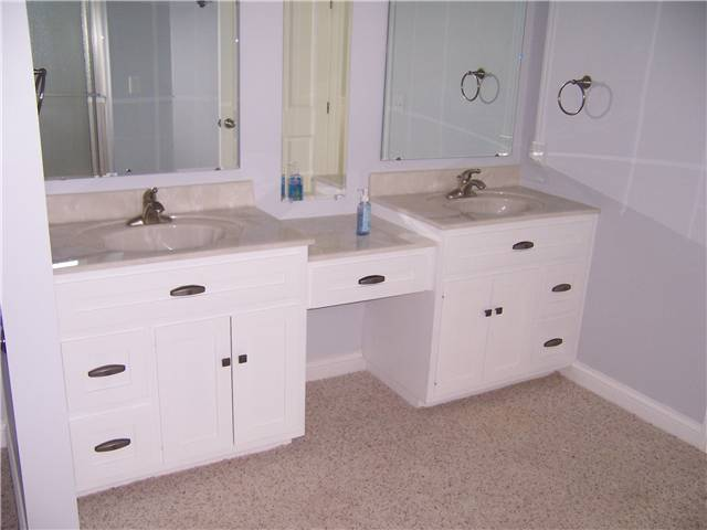 Painted cabinets - Flat panel doors - Standard overlay style - Cultured granite countertops with integral sinks