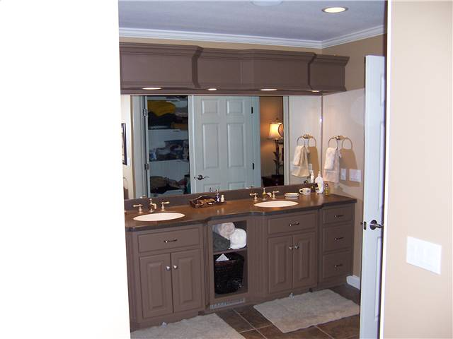 Painted cabinets - Raised panel doors - Standard overlay - Corian solid surface countertops with integral sinks