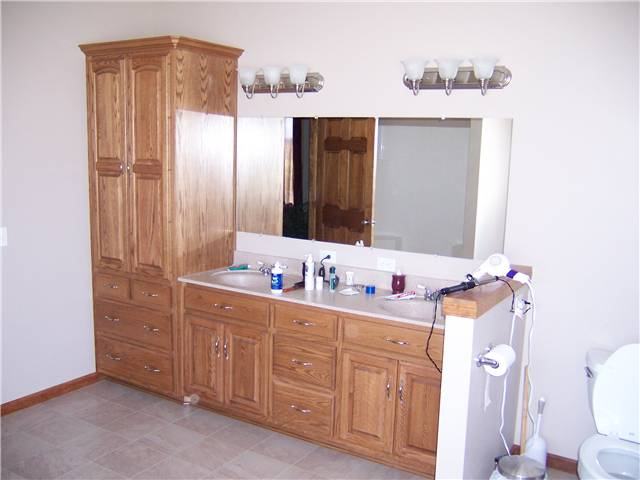 Red oak cabinets - Raised panel doors - Standard overlay style - Cultured marble countertop with integral sinks