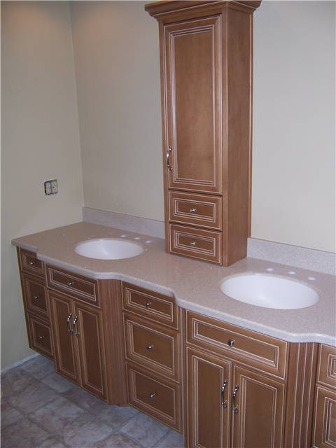 Maple cabinets stained and glazed - Flat panel miter corner doors and drawer fronts - Full overlay style - Corian solid surface coubtertop with integral sinks