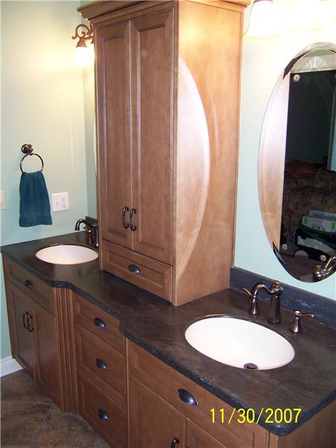 Maple cabinets stained and glazed - Flat panel doors and drawer fronts - Full overlay style - Corian solid surface countertop with integral sinks