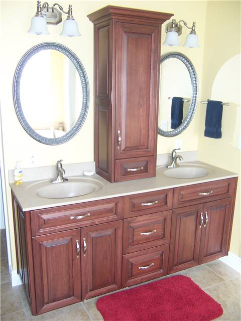 Poplar cabinets - Raised panel, miter corner doors and drawer fronts - Full overlay style - Cultured marble countertop with integral sinks